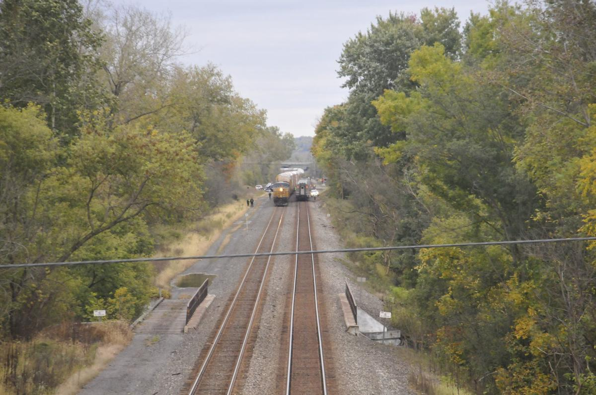 Train strikes truck stuck on tracks in Cayuga County town of