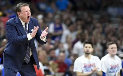 Kansas head coach Bill Self encourages his team form the bench in the second half against Villanova during an NCAA Tournament national semifinal on Saturday, March 31, 2018, at the Alamodome in San Antonio, Texas.