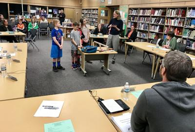 Driver Middle School fourth-graders present invention prototypes to Marcellus school board