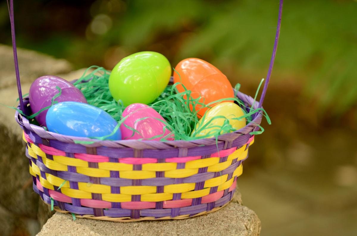 colorful easter basket with plastic eggs