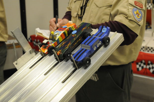 Pinewood Derby cars at starting gates