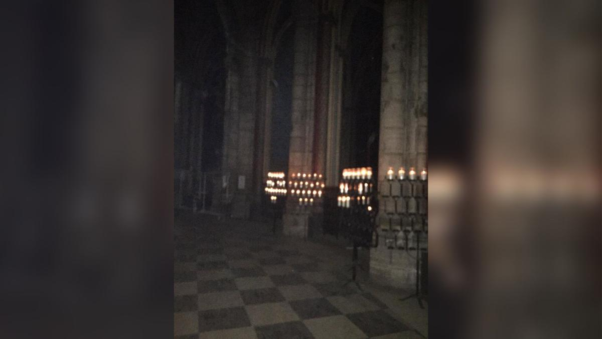 Candles Burning Inside Notre Dame Cathedral | | auburnpub com