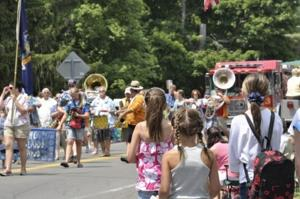 Onlookers enjoy the Fourth of July Parade put on by the Owasco Fire Department on Wednesday afternoon.