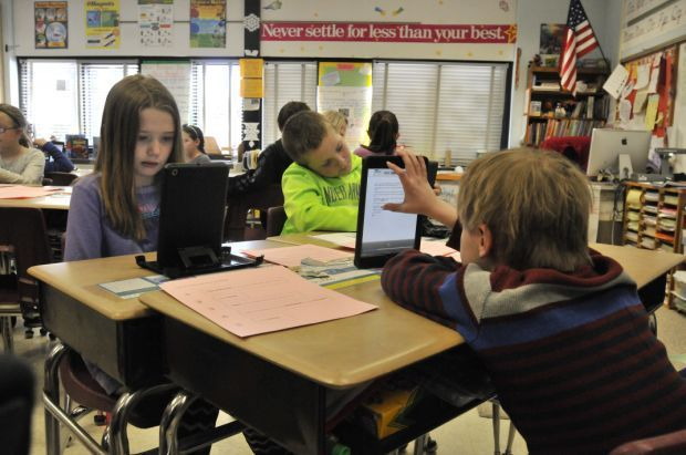 Students interact with iPads
