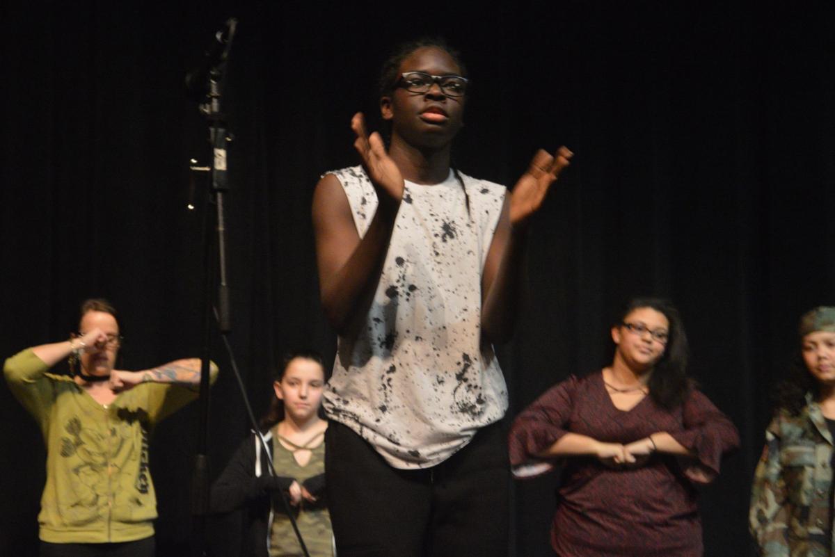 Auburn Junior High School celebrates Black History Month in song, verse