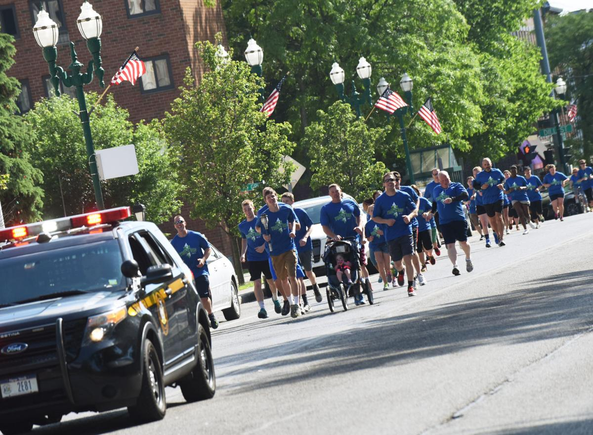 New york cayuga county - Law Enforcement Members Escort Special Olympics New York Torch Across Cayuga County During Torch Run