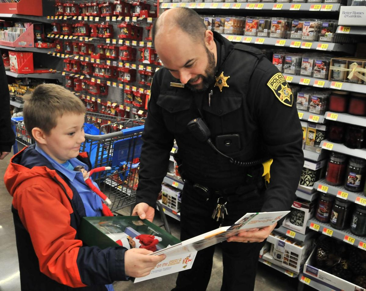'Best Christmas ever': Children shop with cops for the holidays in Auburn
