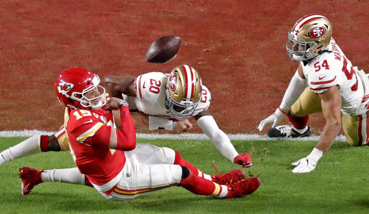 San Francisco 49ers' Jimmie Ward (20) tackles Kansas City Chiefs quarterback Patrick Mahomes (15), who fumbles during the first quarter of Super Bowl LIV at Hard Rock Stadium in Miami Gardens, Fla. on Sunday, Feb. 2, 2020.