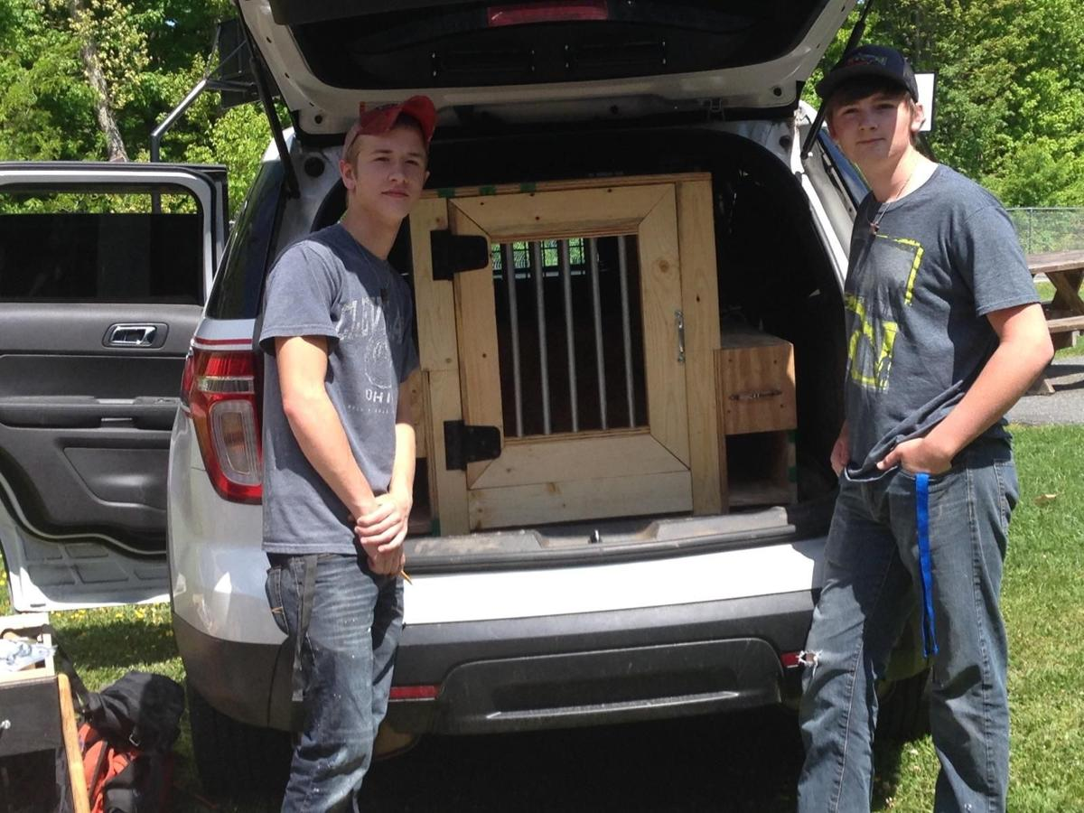Carpentry students construct crates for ACSO K9s