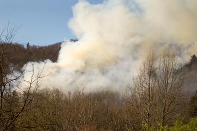 Smoke plumes new cutline