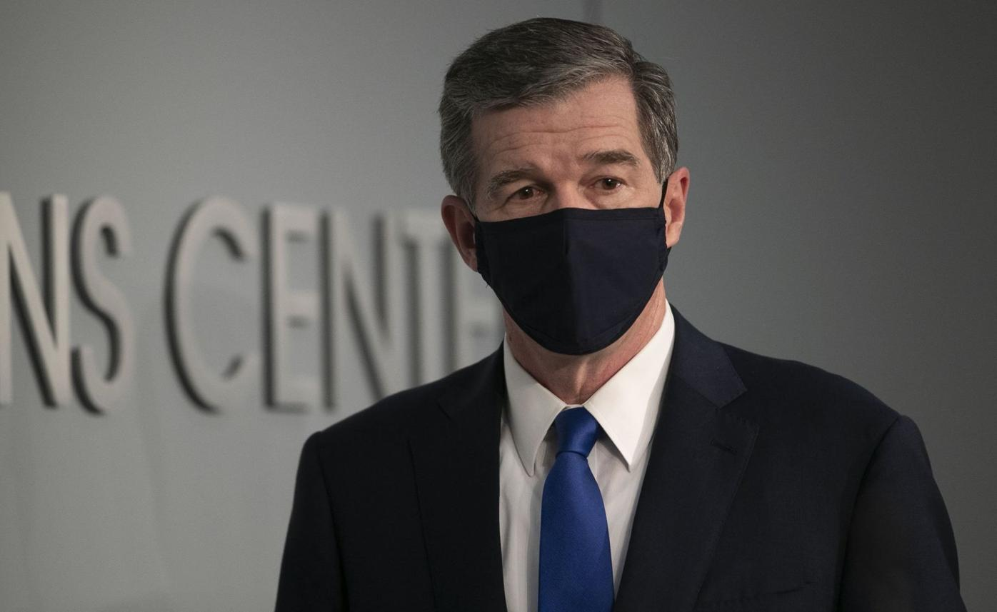 Cooper wearing a mask