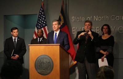 Gov. Roy Cooper announces school closures