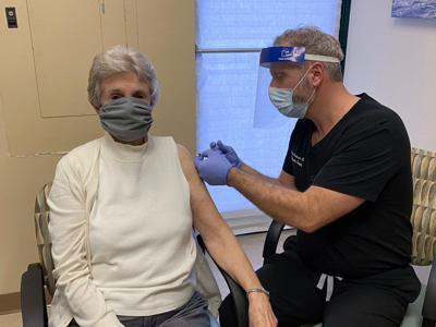 Dr. Anderson vaccinates Katie Lineback