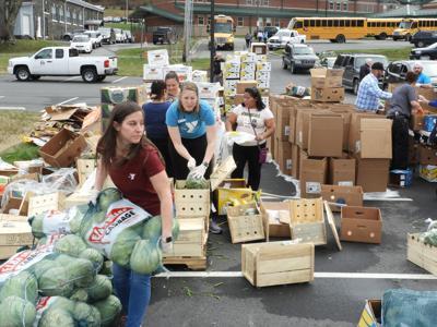 Volunteers distribute food at community market