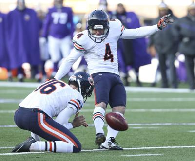 Chicago Bears kicker Jay Feely (4) scores a field goal after the interception by Chicago Bears cornerback Kyle Fuller (23) against the Minnesota Vikings during the second half of their game on Sunday, Dec. 28, 2014 at TCF Bank Field, in Minneapolis, Minn.