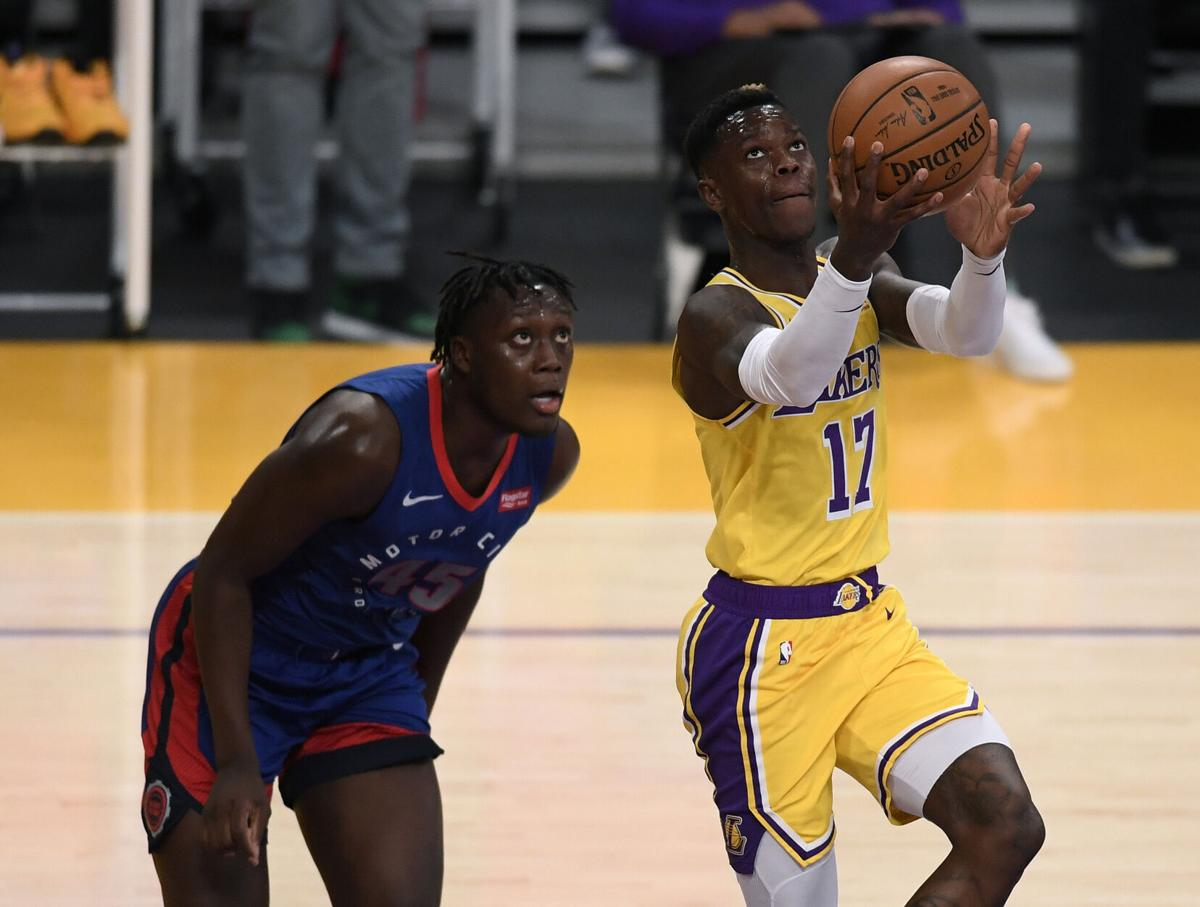 Dennis Schroder of the Los Angeles Lakers scores in front of Sekou Doumbouya of the Detroit Pistons during the first half on Saturday, February 6, 2021 at Staples Center in Los Angeles, California.