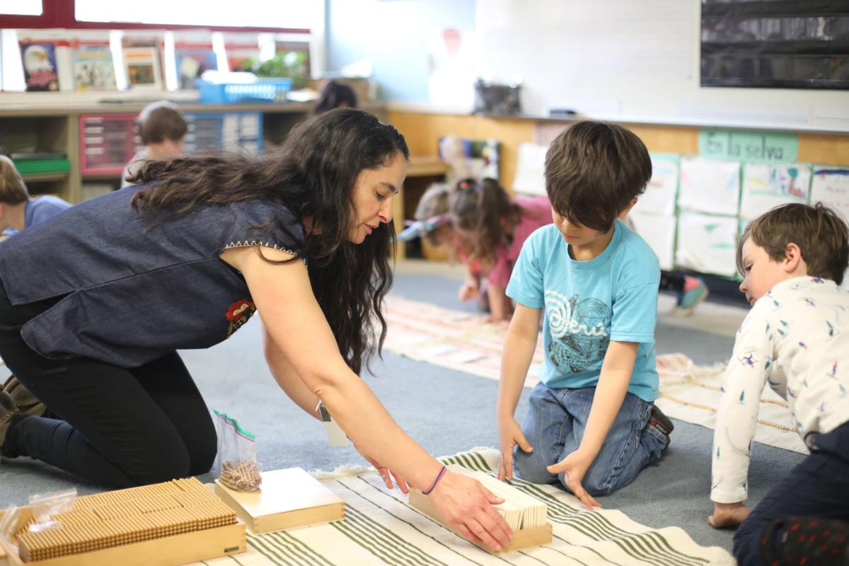 Puente De Hozho's Susan Spizzirri works with her students in one of the school's new multiage learning programs Friday morning.