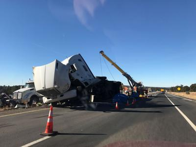 Semi-truck rollover slows traffic on I-40 near Williams