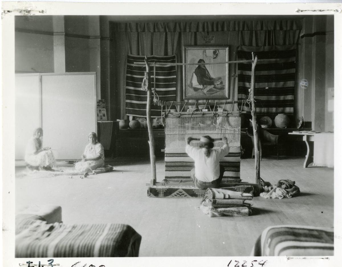 A weaving demonstration at the first Hopi Craftsman Show in 1930.tif