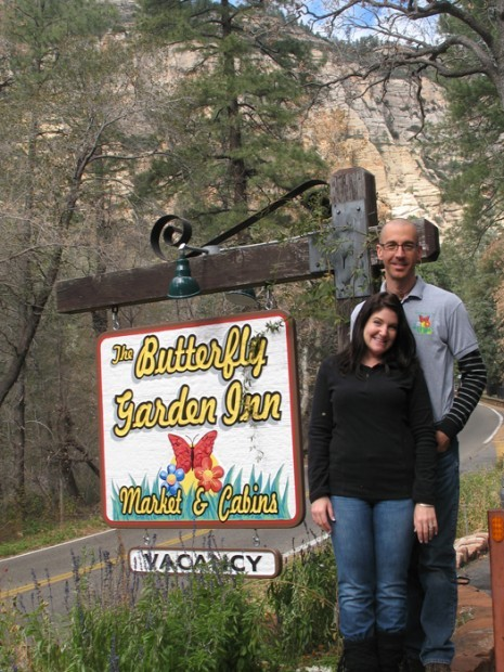 Frank And Nichole Garrison Stand Beside The Sign For Their Newly Opened Butterfly  Garden Inn In Upper Oak Creek Canyon. The Couple Has Restored The Old ...