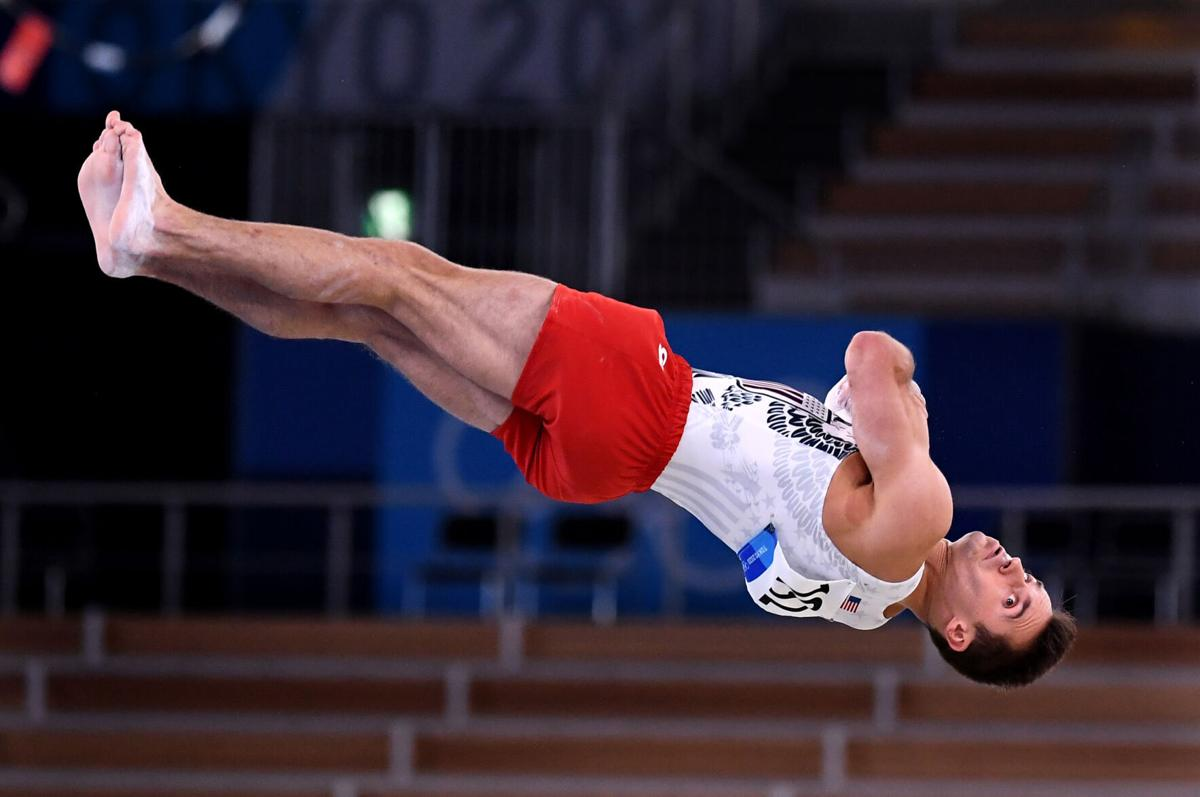 The United States' Samuel Mikulak competes in the floor exercise during Men's Team Gymnastics qualifying at the 2020 Tokyo Olympics on Saturday, July 24, 2021, in Tokyo.
