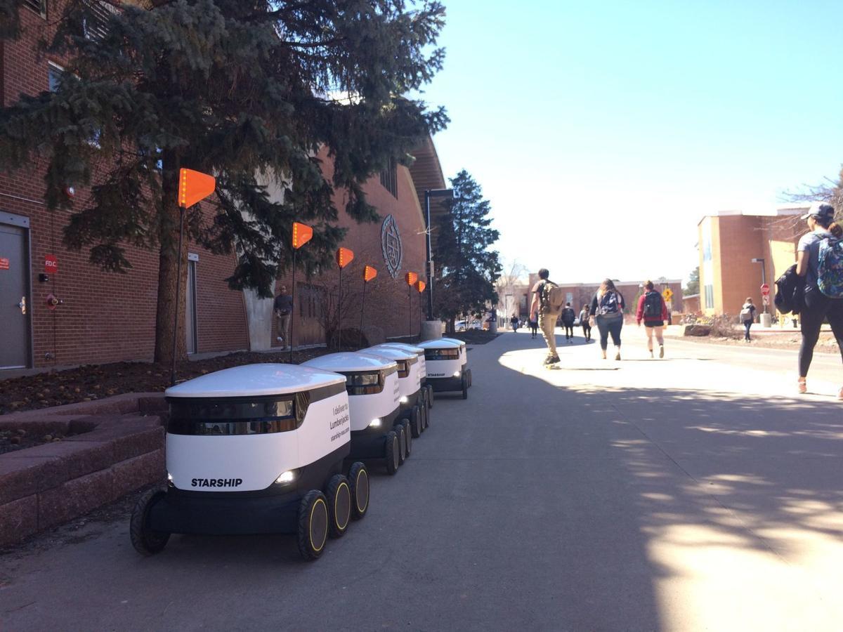 Seven robots in a row