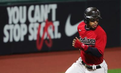 Cleveland Indians shortstop Francisco Lindor rounds third on his way to home plate during the fifth inning of Game 2 of the American League Wild Card Series, Wednesday, Sept. 30, 2020, in Cleveland, Ohio.