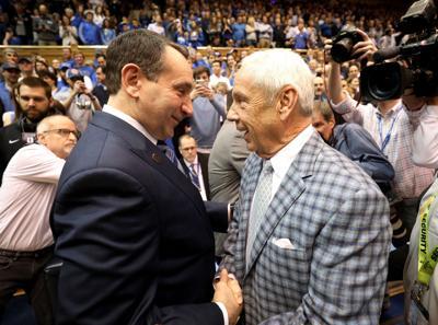 Duke head coach Mike Krzyzewski, left, talks to North Carolina head coach Roy Williams before a 2018 game at Cameron Indoor Stadium in Durham, North Carolina.