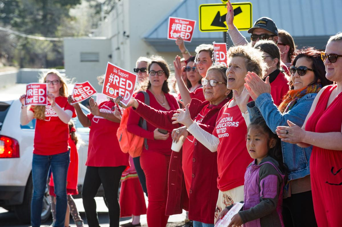 7d118f09 First-grade teacher Kate Mareck, fourth from right, joins Pine Forest  students and teachers participating in the Red for Ed demonstration outside  Pine ...