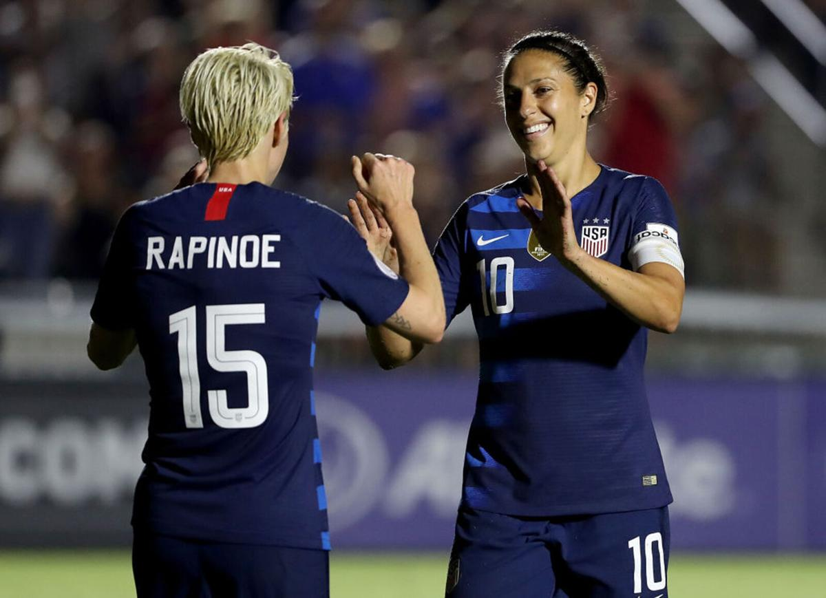 Megan Rapinoe #15 reacts after scoring a goal with teammate Carli Lloyd #10 of USA against Mexico during the Group A- CONCACAF Women's Championship at WakeMed Soccer Park on October 4, 2018 in Cary, North Carolina.