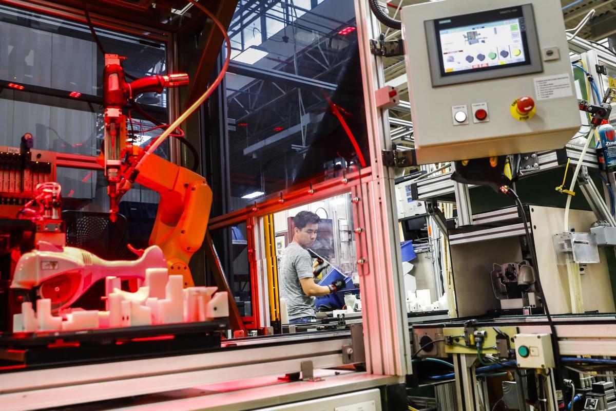 APTOPIX Future of Work Running the Robots