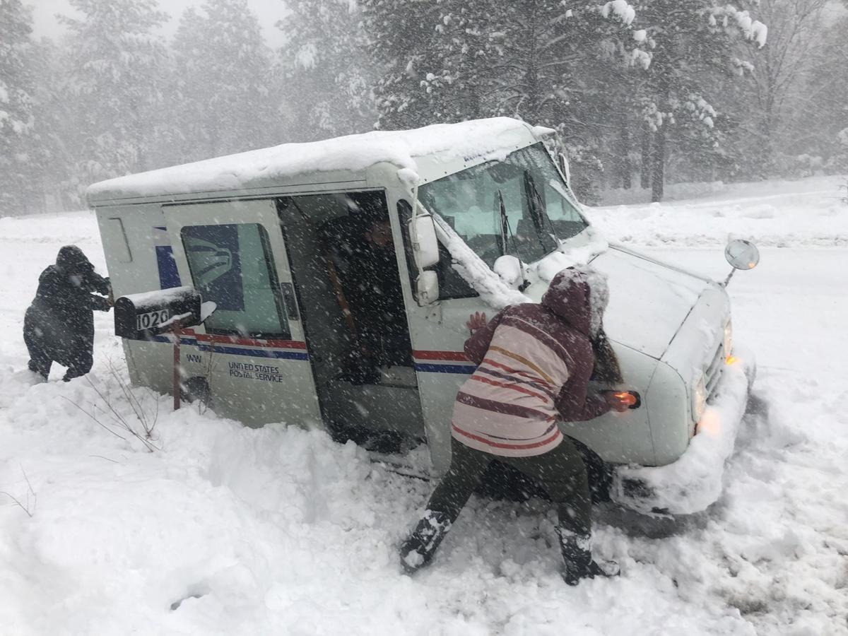 Postal Truck stuck in snow