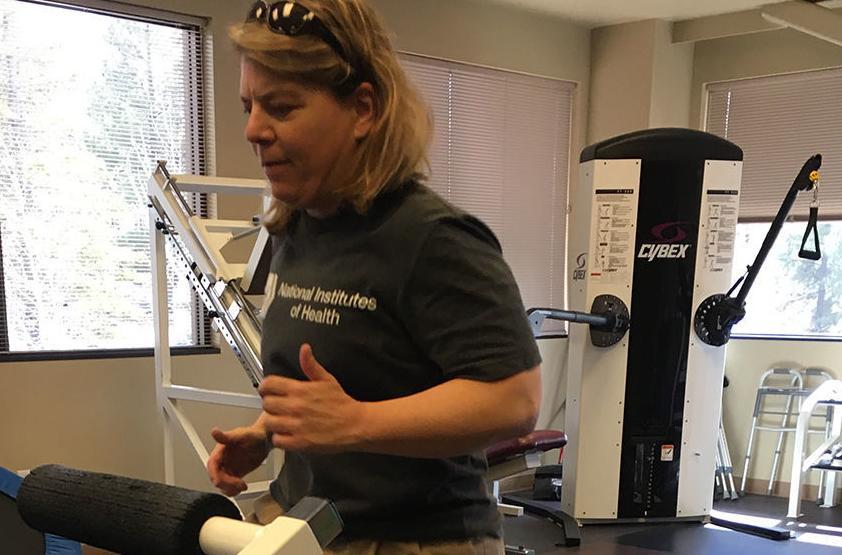 Peak of Health: NAU professor hangs by her fingertips from Havasu Falls