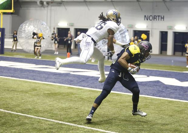 Northern Arizona University wide receiver Dejzon Walker (5) completes a pass on his way to a touchdown against Montana State Saturday. (Taylor Mahoney/Arizona Daily Sun)
