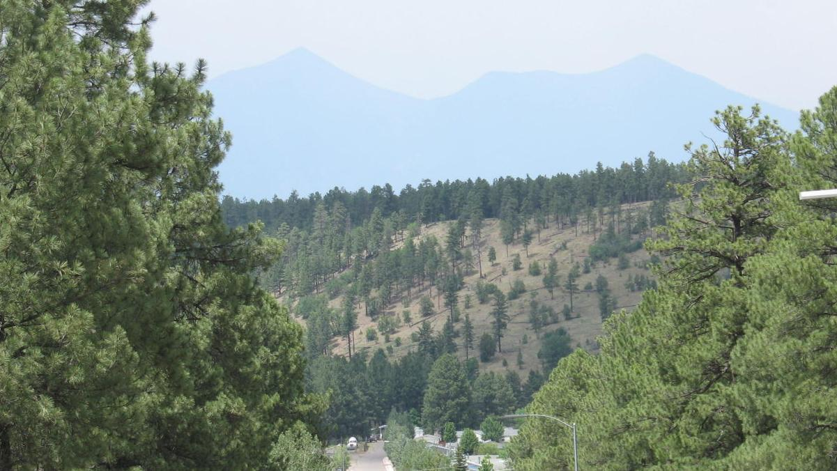 Boundary Fire smoke drifts south, illegal campfire sparks fire near Fisher Point