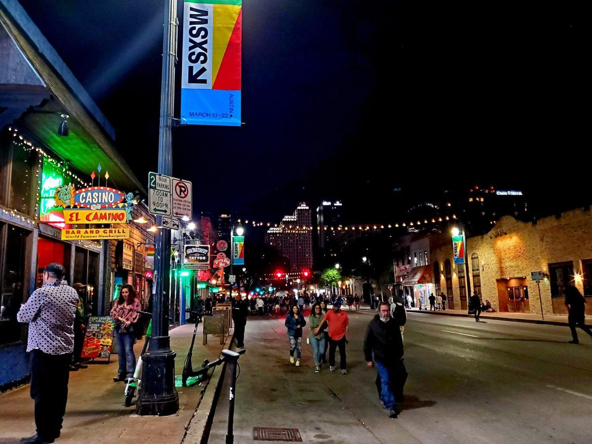 Even after Austin's mayor effectively canceled the South by Southwest festival, people still flocked to downtown Sixth Street.