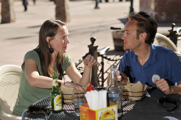 Lauren Cain, left, and Peter Dorsey eat lunch on the outside patio of Diablo Burger Monday at Heritage Square downtown.   (Cole Johnson/Arizona Daily Sun/Order this photo at http://photos.azdailysun.com)