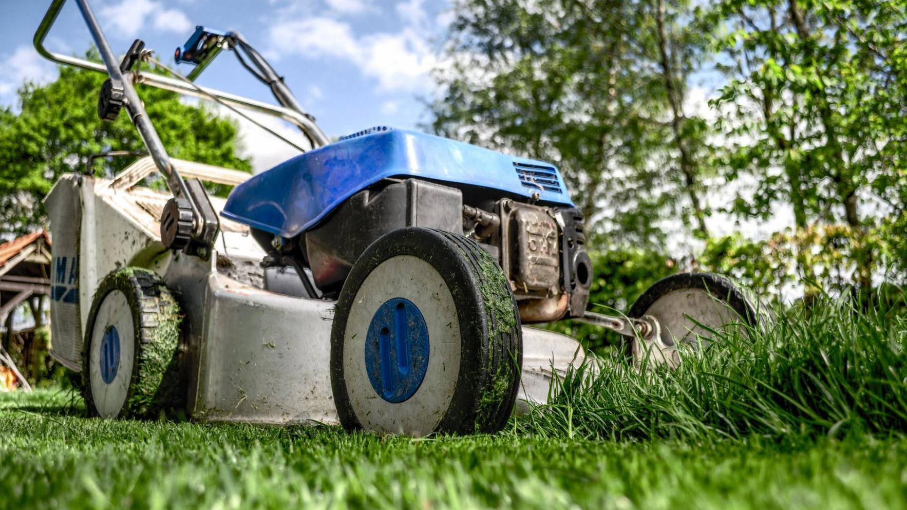 Should I sharpen or replace my lawn mower's blades?