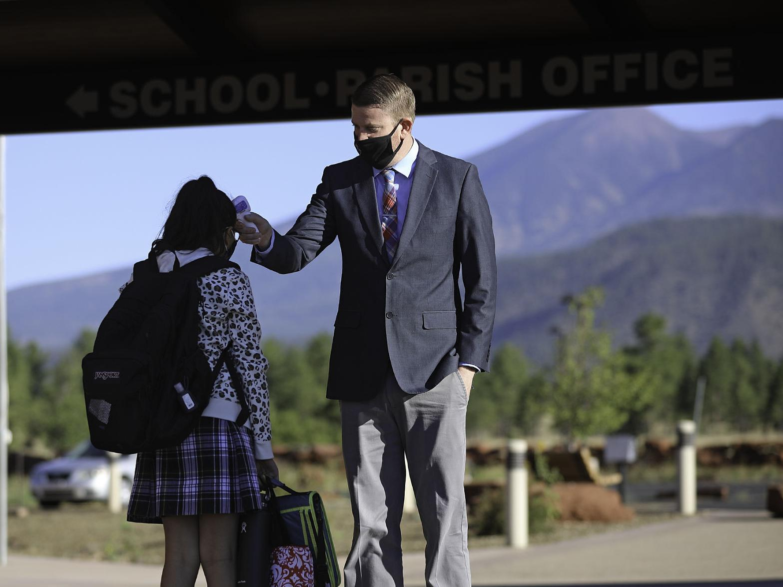 Adapting to COVID-19 class procedures: Students return to San Francisco de  Asis Catholic School | Local | azdailysun.com