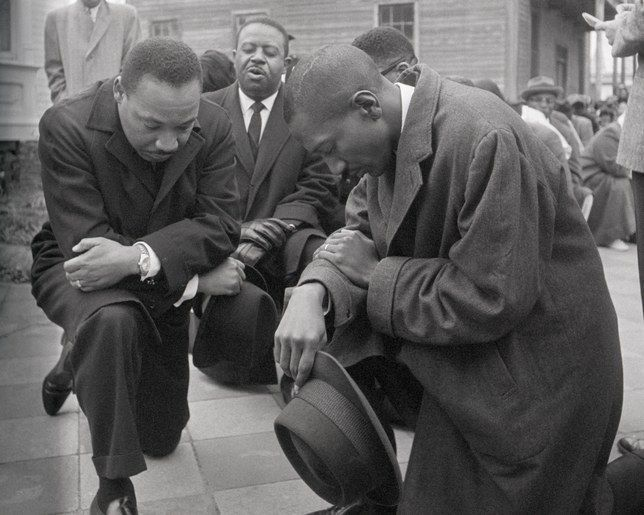 Martin Luther King Jr. kneeling