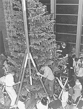 1956: Christmas tree decorating party