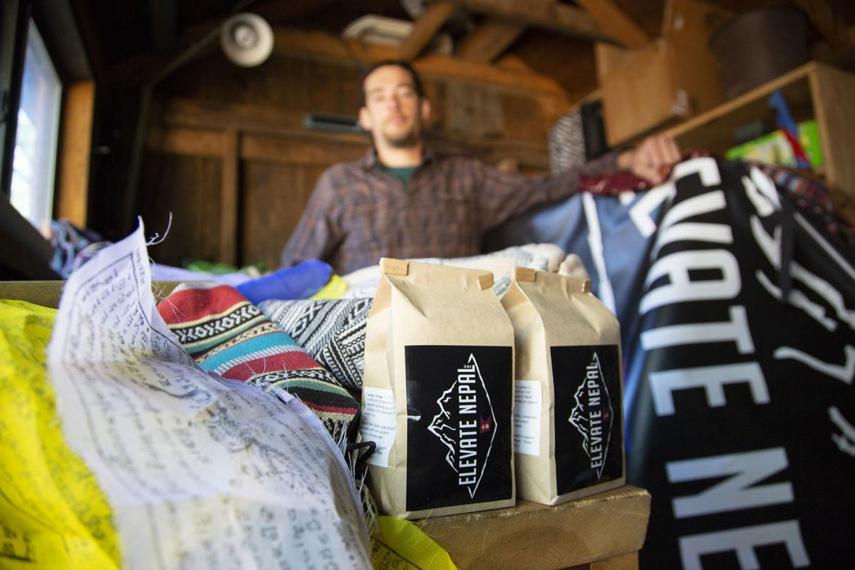 Anthony Mancini, co-founder of Elevate Nepal, Inc., stands in a storage room with merchandise from Nepal he sells to support the mission of the nonprofit..jpg