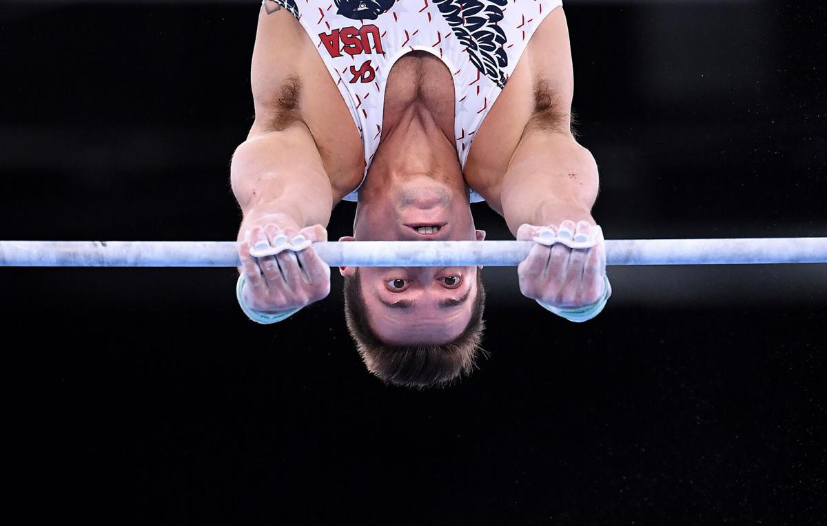 The United States' Samuel Mikulak competes on the high bar during Men's Team Gymnastics qualifying at the 2020 Tokyo Olympics on Saturday, July 24, 2021, in Tokyo.