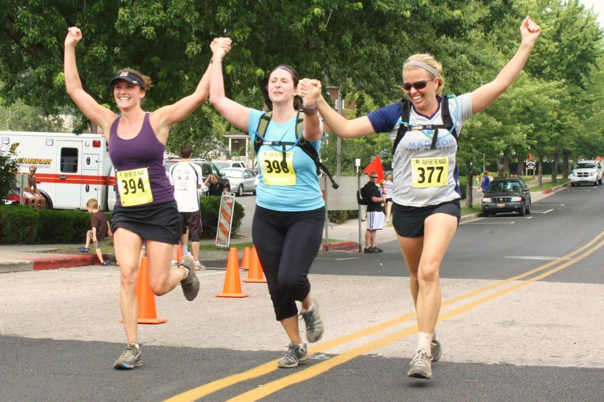 Three happy runners completing a BBBSF race in earlier years