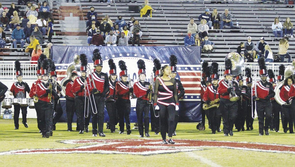 Aizhia Poblete leads the Pirate Brigade onto the field at halftime.jpg