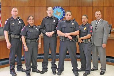 Police department welcomes 1, promotes 3