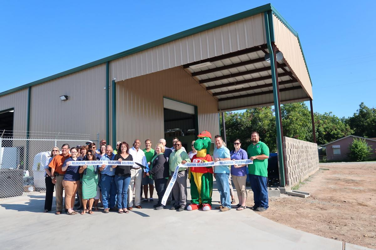 Ribbon cutting for movement of Recycling Center