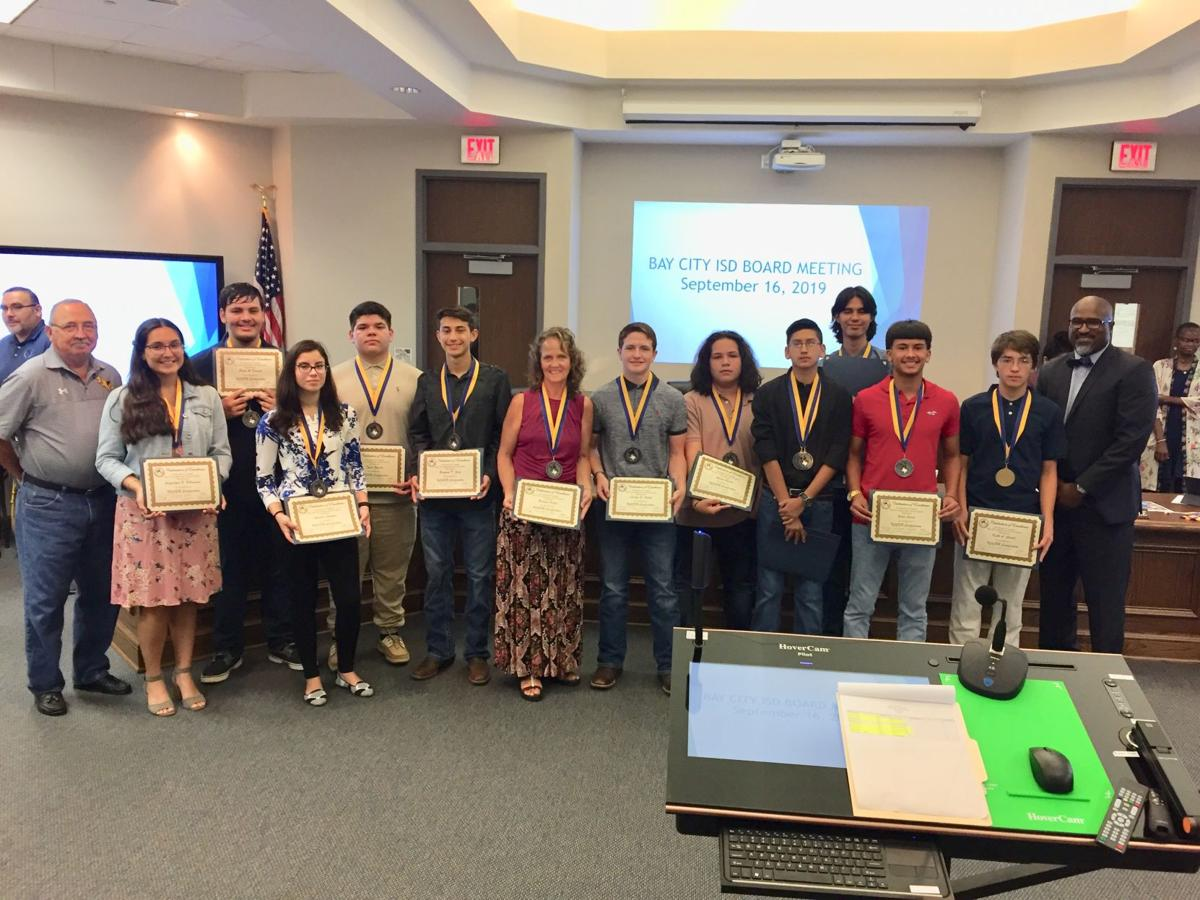 Trustees recognize students at board meeting