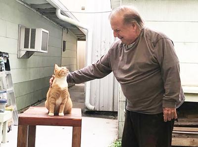 Charlie the cat cashes in on first place finish in pet photo contest