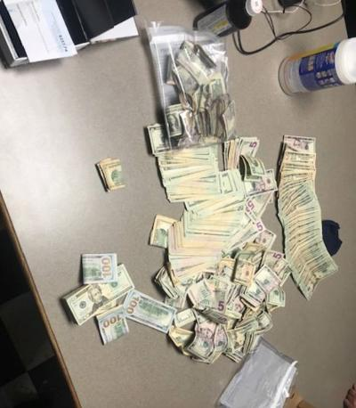Search warrants net drugs, cash ...